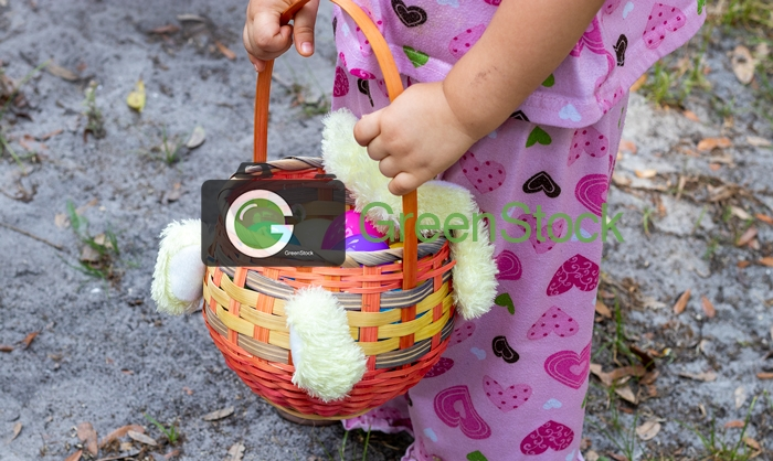 A toddler holding an Easter basket